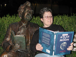 A bronze Mark Twain from Monrovia's Library Park studies the Moon Atlas with Jane.